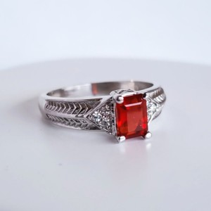 Mexican Fire Opal set in 14KT White Gold with round Diamonds